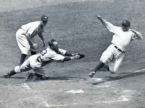 Babe Ruth slides safely into home during a 1934 Yankees-Tigers game. (AP)