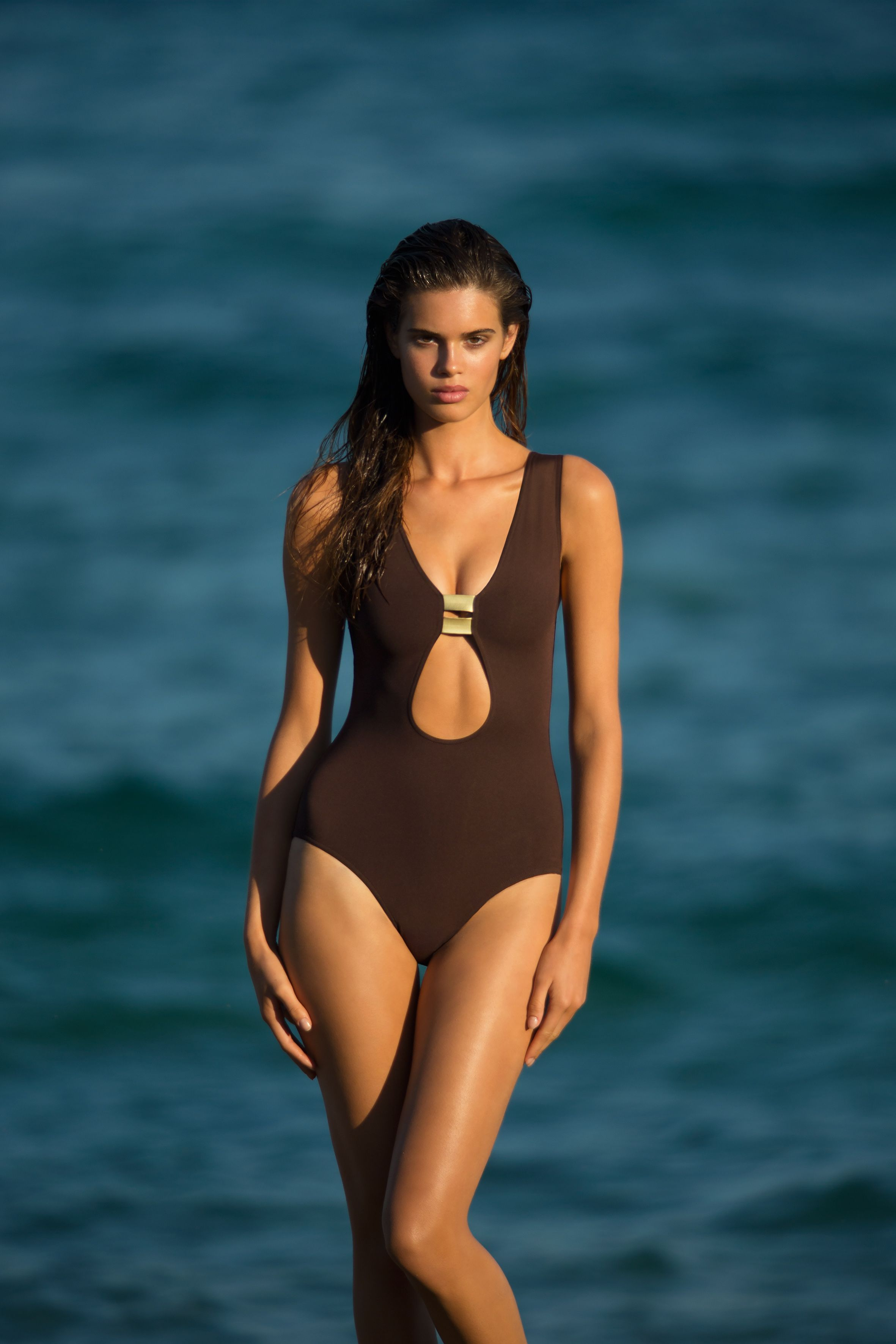 406ca042c44 ERES Swinsuit S/S 2015 Collection. One-piece swimsuit in Peau Douce, deep  tear-drop neckline enhanced with gold-coloured bands, covered back.