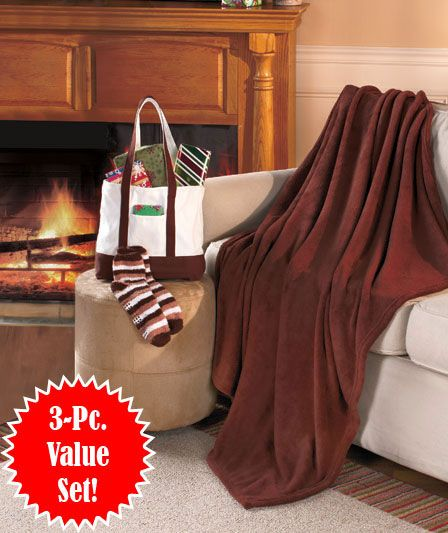 An incredibly soft throw and a pair of coordinating nonslip socks come inside a tote bag that can be used again and again... makes a thoughtful gift!  #holiday