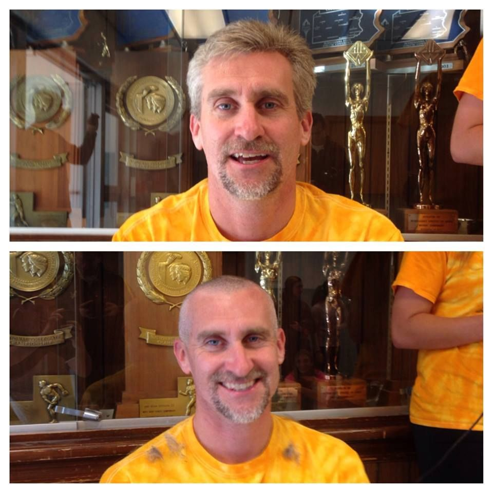 Coach Andy Young shaved his head after the One Day Give target goal was hit.
