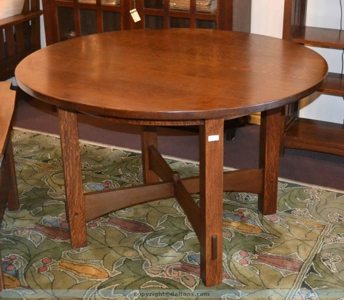 "Gustav Stickley 48"" fixed round dinning table, stands 30"" tall, paper label and dates circa 1910. Very good condition with a respectable recent finish."