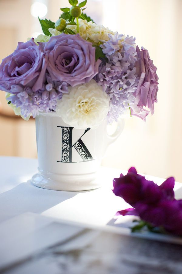 Anthro mug for flowers  Read More: http://www.stylemepretty.com/2011/01/26/washington-wedding-by-sea-studio-photography/