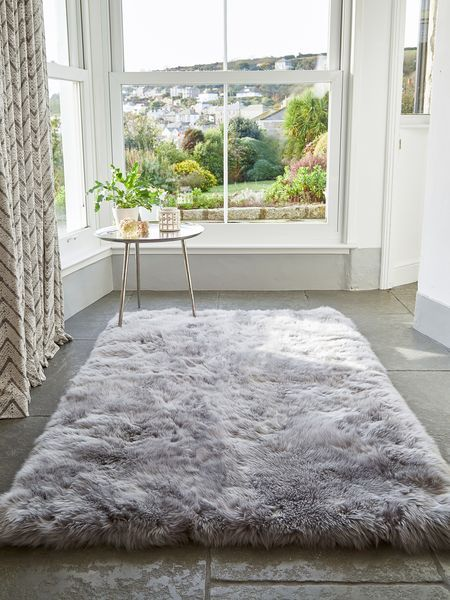 grey rug living room round chair this large long wool sheepskin creates a rustic or modern style depending on the chosen decor