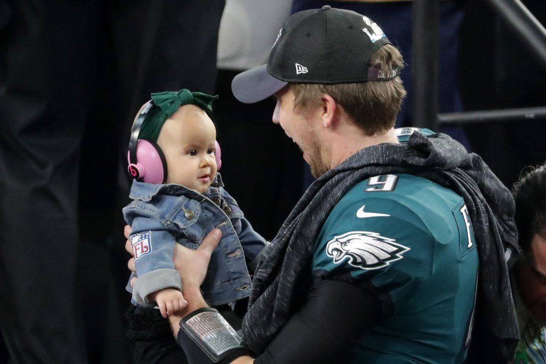 Super Bowl Mvp Nick Foles 7 Month Old Daughter Stole The Show With Her Cute Pink Headphones Philadelphia Eagles Football Philadelphia Eagles Fans Philadelphia Eagles Baby