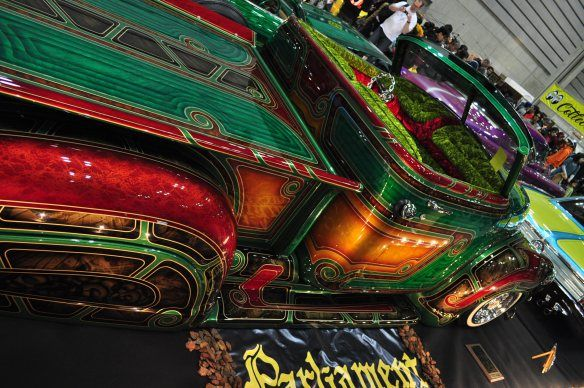 """Chevy in Japan with intricate paint job. They've embraced the """"Chicano"""" style, which uses a lot of intricate patterned paint jobs. Most lines on these vehicles represent an individual paint session. The painter will lay down the design with tape and then spray the area, let dry, remask, respray, let dry and repeat."""