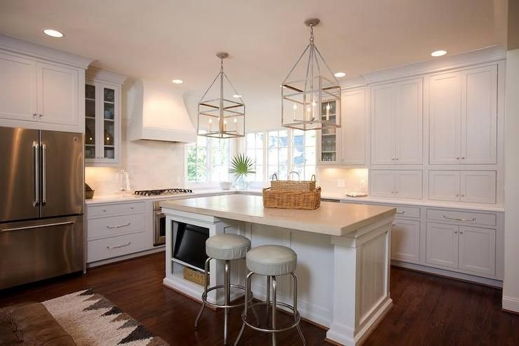 L Shaped Kitchen Features A White Plaster Range Hood Over An Integrated Gas Cooktop And Oven