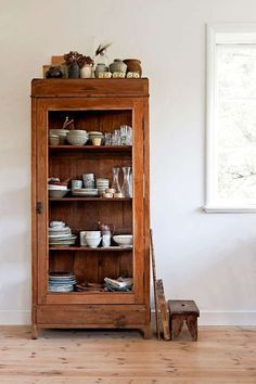 Photo of Antique glass door cabinet. So many uses.