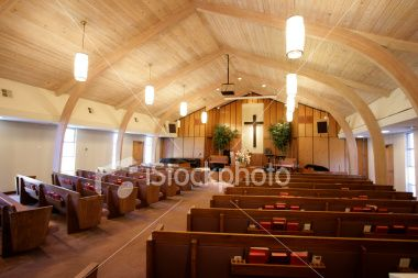 Small church interior with aisle,pews,hymn books, and pulpit ...