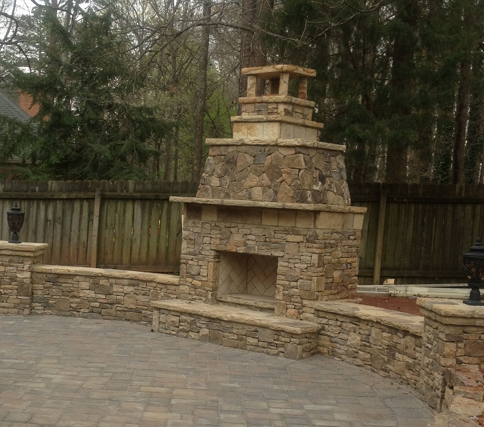 Stacked stone knee walls make great seating area by this
