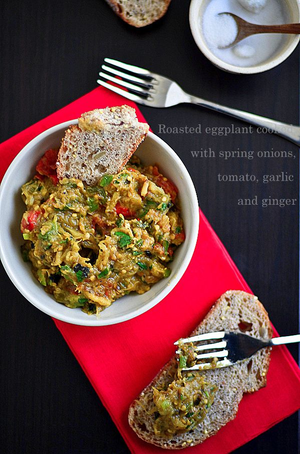"(best with naan, ciabatta, or rice: 1 eggplant, 4-6 garlic cloves, olive oil, spring onions, 2-3 green chillies, red chili powder (optional), turmeric powder, coriander powder, 1"" piece ginger, 1/2 small roma tomato, 3 T chopped roasted red pepper, freshly chopped cilantro, and salt to taste)"