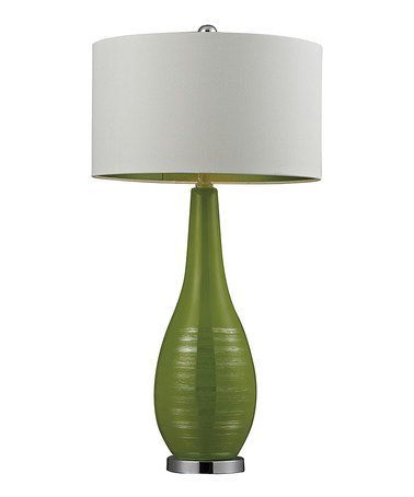 Loving this bright green ceramic table lamp on