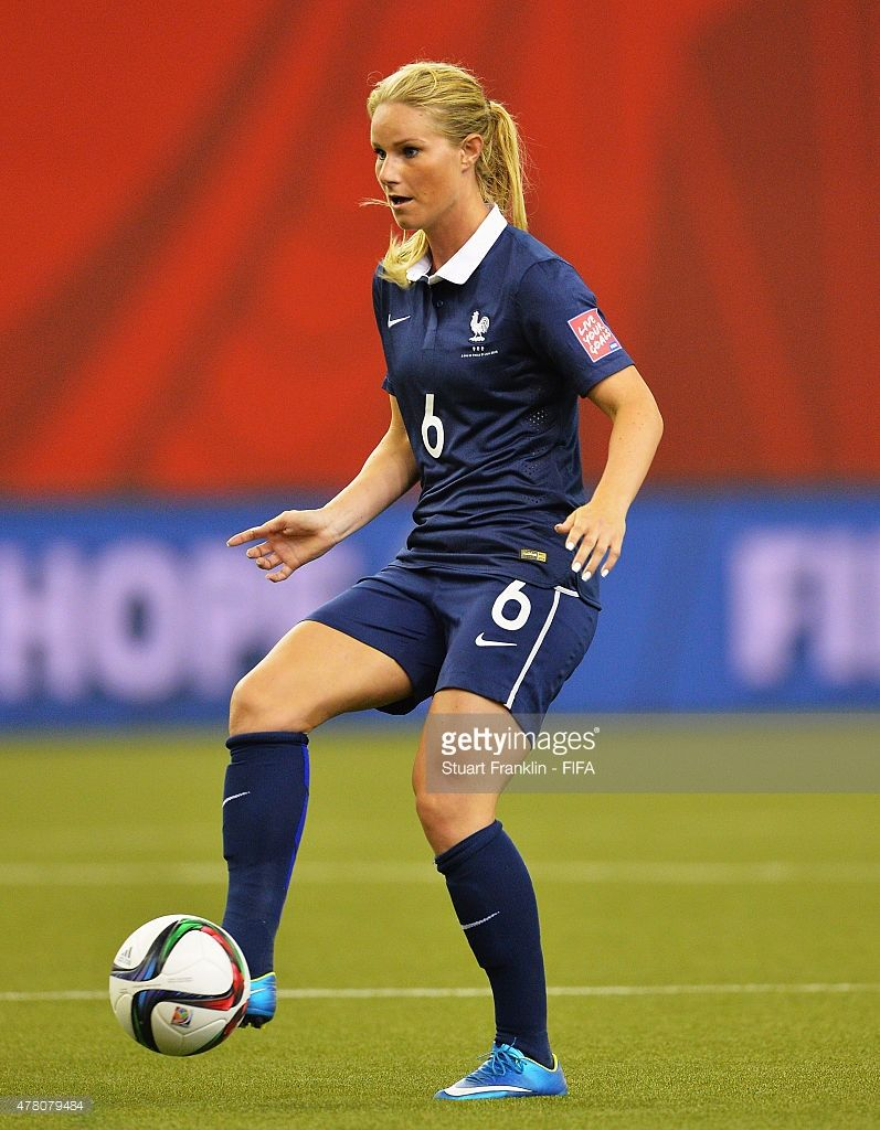 Amandine Henry of France is challenged by of Korea during