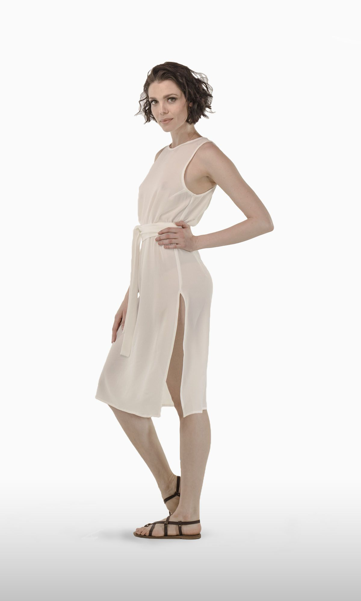 The Katie Dress in Ivory Rayon | JOSA tulum's Katie is just sexy! Feel chic on the beach and take it out for a night of dancing under the stars. The Katie is a mid lenght dress that features high tight slits on both sides, a fabric belt and discrete opening on the back.