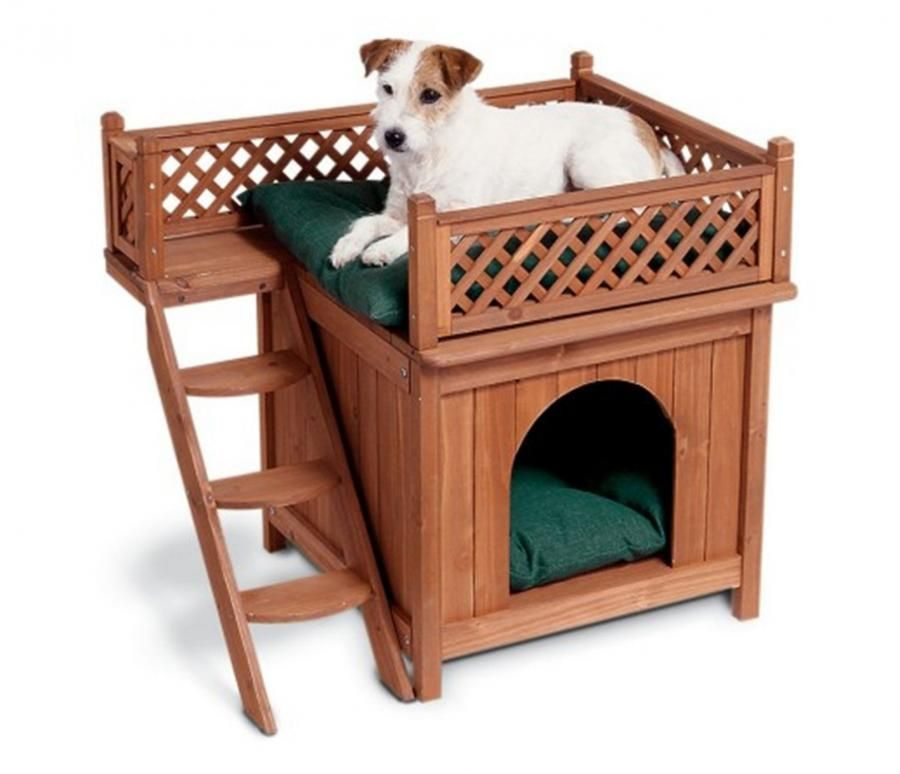 This dog bunk bed is made to look like a small wooden home with a