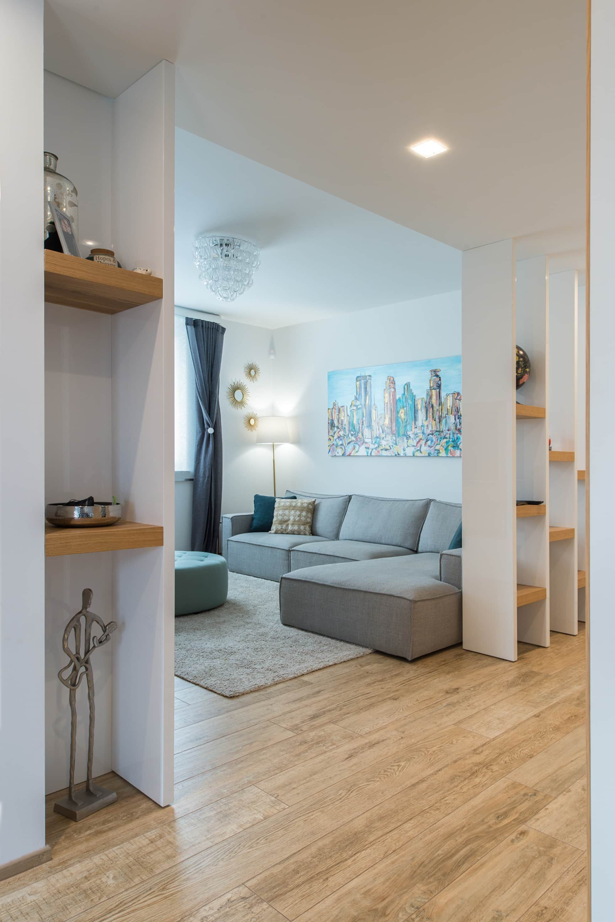 Photo of A modern apartment with the right mix of recycled materials: Living room in …