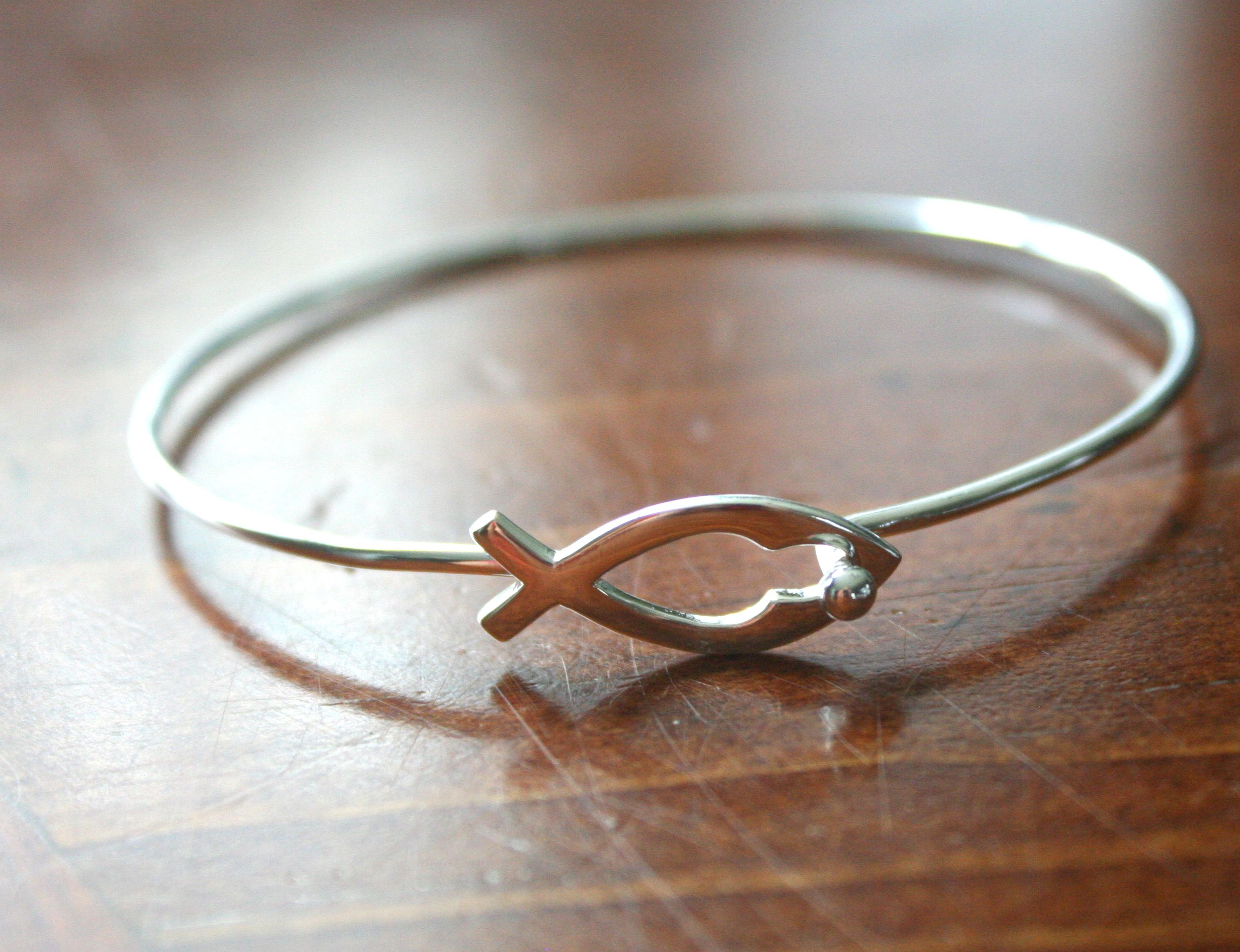 This symbolic sterling silver ichthus jesus fish bracelet can be symbolic sterling silver ichthus jesus fish bracelet can be worn everyday to symbolize your christian faith a traditional symbol for jesus and christians biocorpaavc Image collections