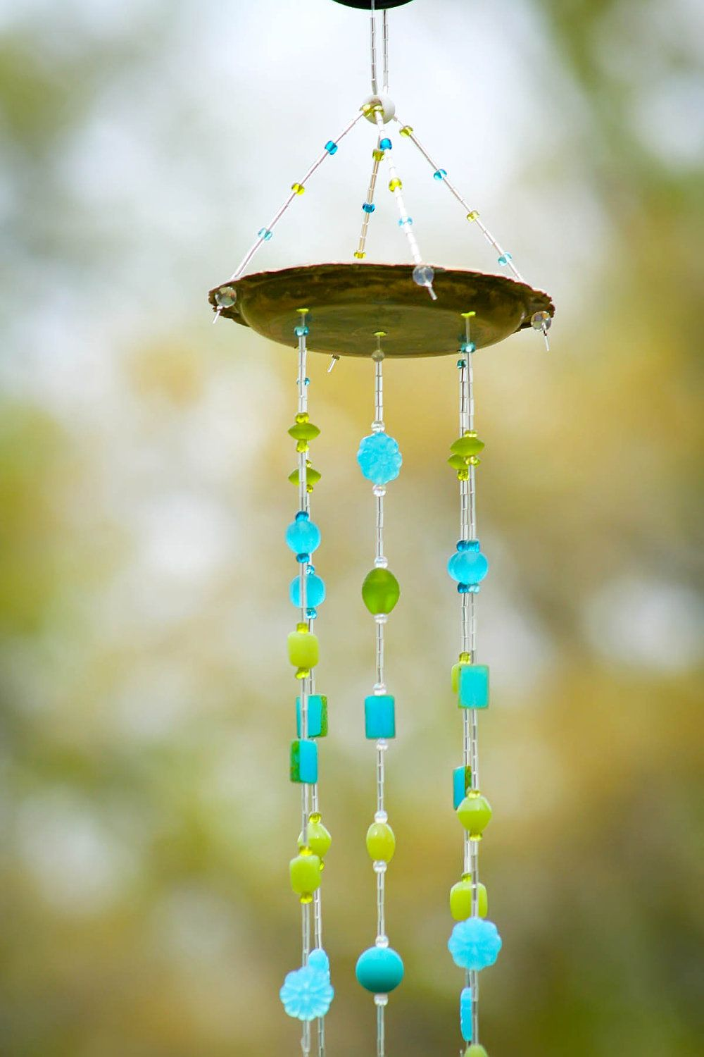 windchime made from small antique dish and silverware with curly forks. $30.00, via Etsy.