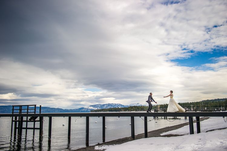 The first look of an Anne Barge bride + groom is epic set amongst the backdrop of Lake Tahoe. Real wedding featured on photographer Stacey Pentland's blog.