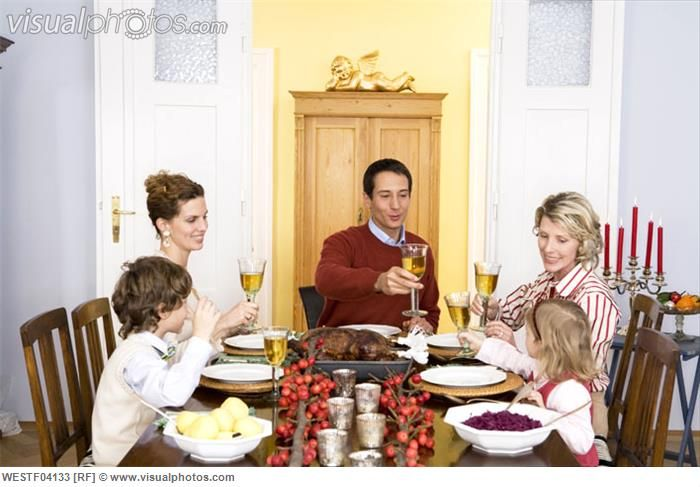 Family Having Dinner | Family having Christmas dinner