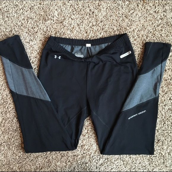 Under Armour Full Length Running Tights Excellent Used Condition!  Black compression tights with silver accents at lower calves and ankles and rear zip pocket! Under Armour Pants Leggings