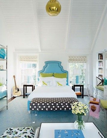 House Beautiful    Fun blue green brown eclectic girl's bedroom design with blue upholstered headboard bed with white brown polka dot bench with lucite acrylic legs. Girl's room, teen's room. White paint wall color! Cute gold disco light pendant! Turquoise blue brown pink gold yellow green bedroom space colors