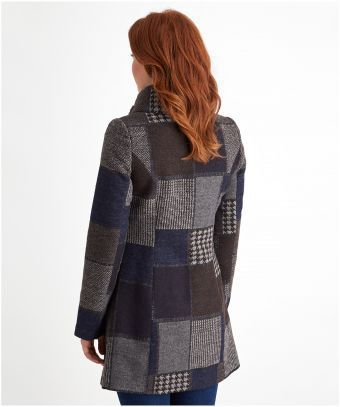 Enjoy patchwork perfection in this quirky coat. Bringing together beautiful…