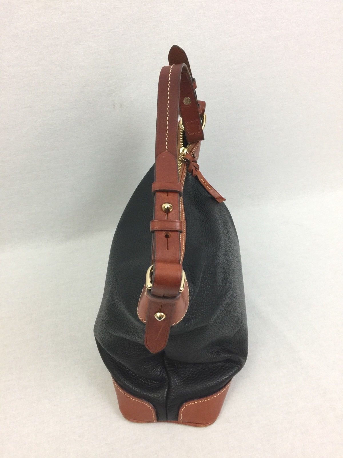 Dooney and Bourke Black Pebble Leather Hobo Style Womenus Purse
