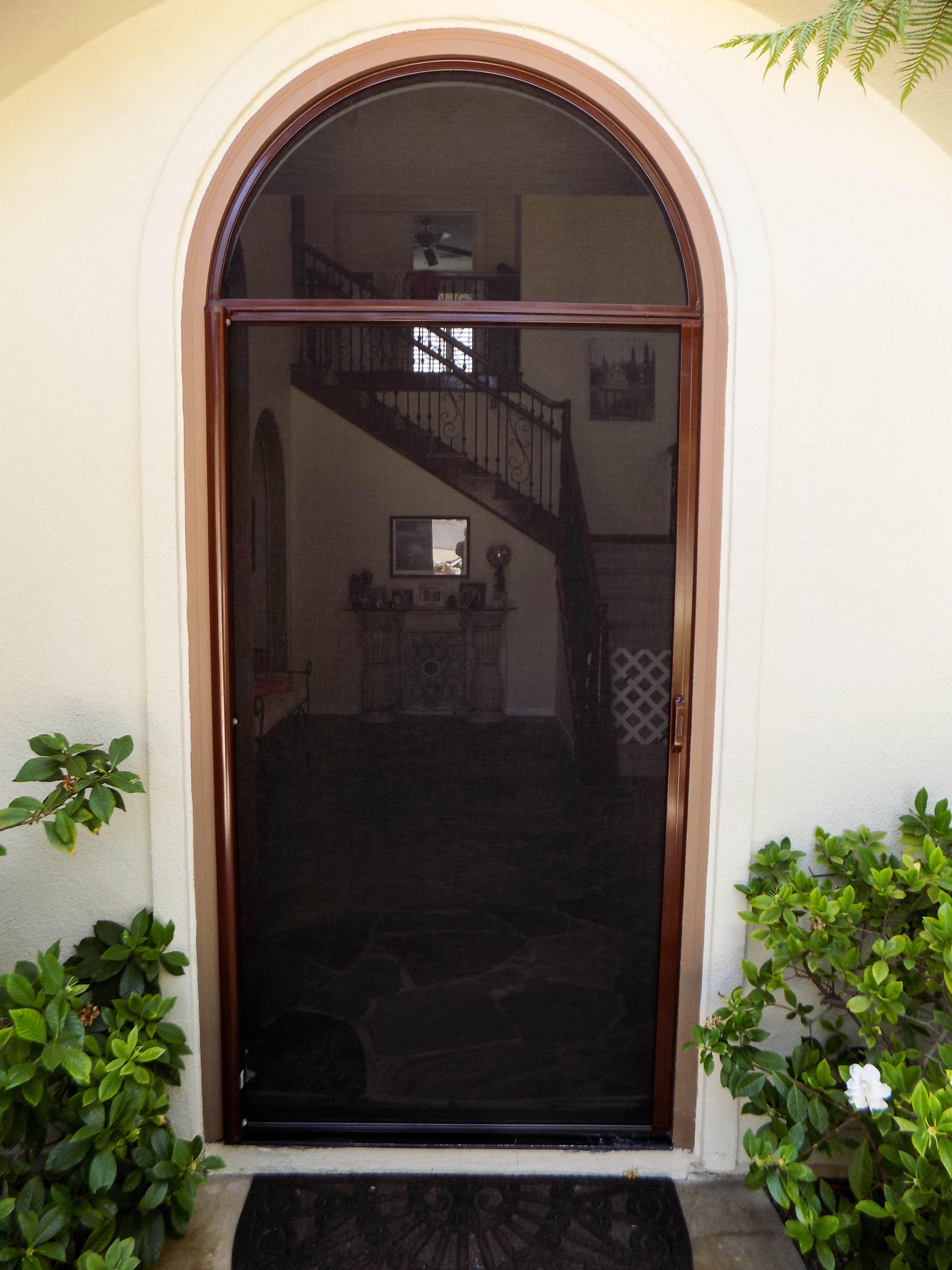 Arched single door stowaway retractable screen with