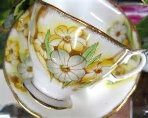 Royal Albert 'Petunia' pattern  teacup and saucer in yellow and green