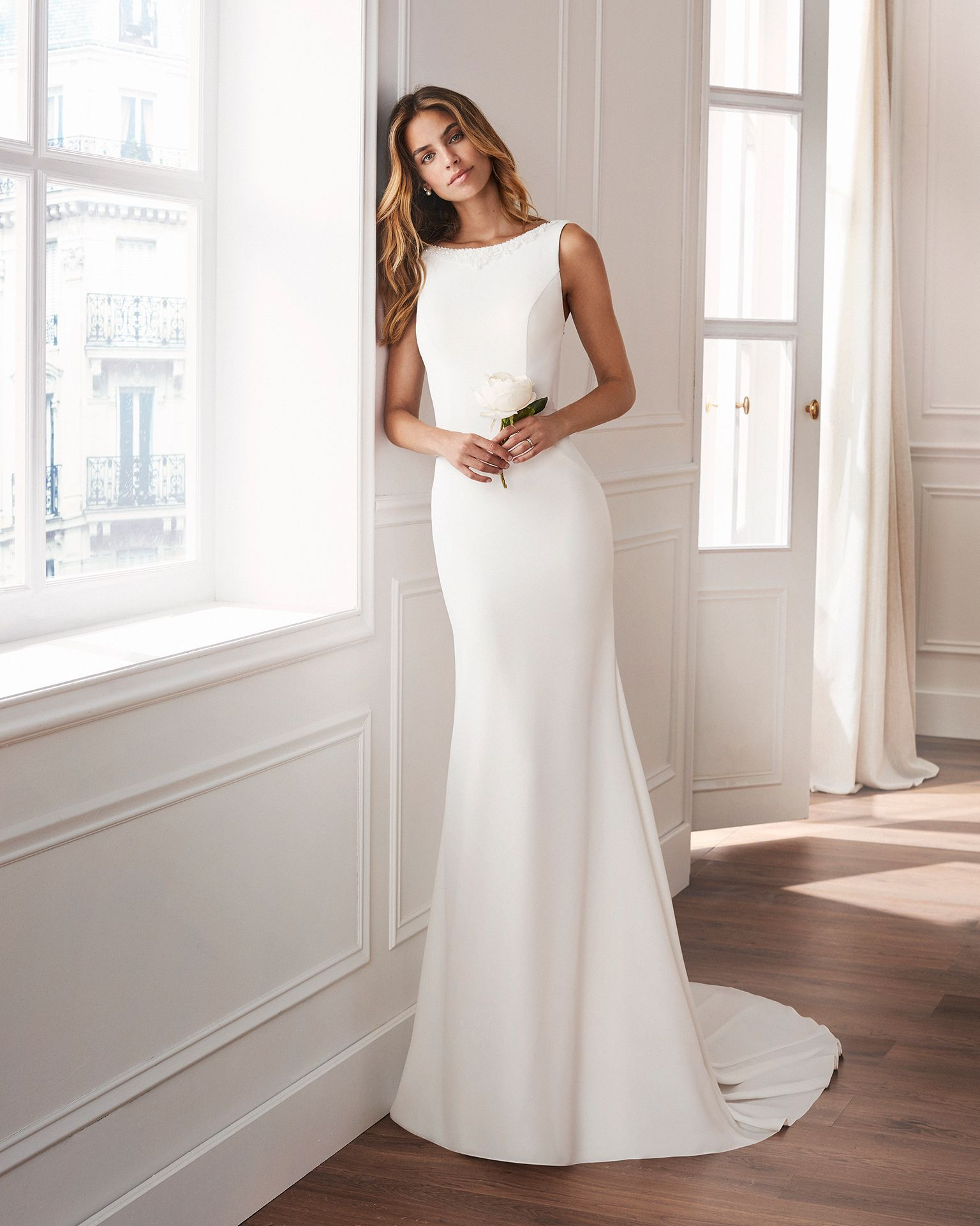 Sheathstyle wedding dress in crepe  With bateau neckline, train and jewelled back  Available in natural  2019 Collection  is part of Wedding dresses -