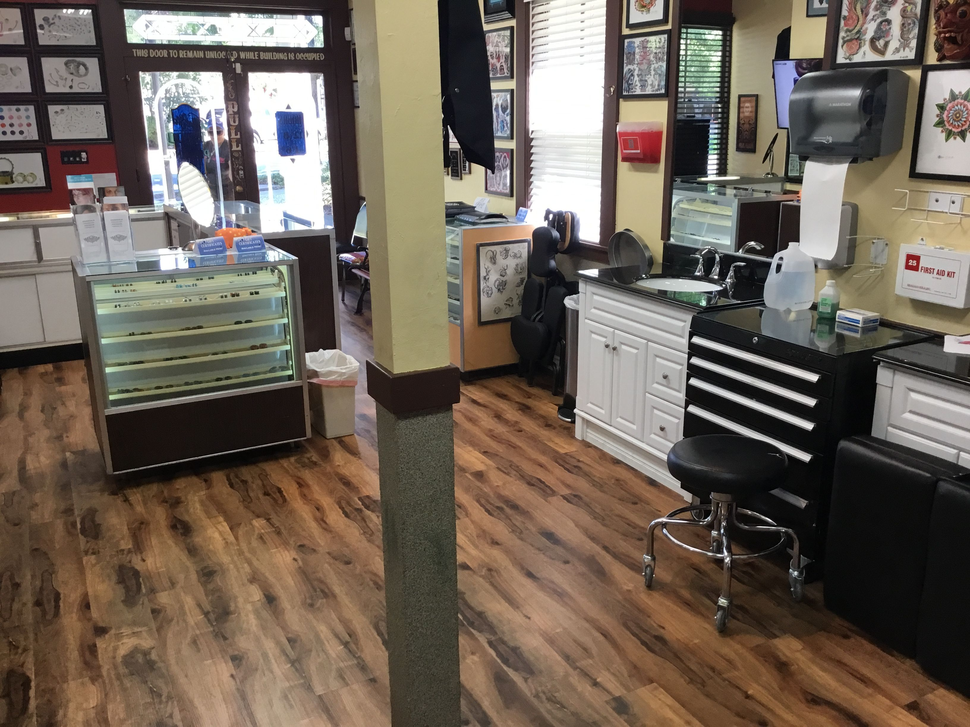 Inside the tattoo shop blue star and body piercing star