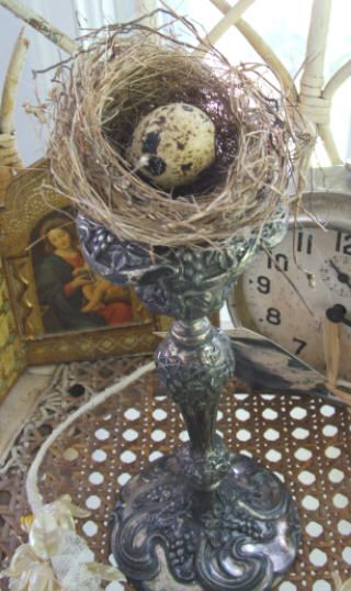 Flea market finds with a darling wispy next tucked in to a candle holder