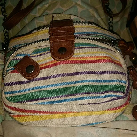 Summertime crossbody Colorful stripes with brown faux leather accents. faint stain on frint, but can hardly be seen in person. Will wash clean before I send it if sold. Mad Love Bags Crossbody Bags