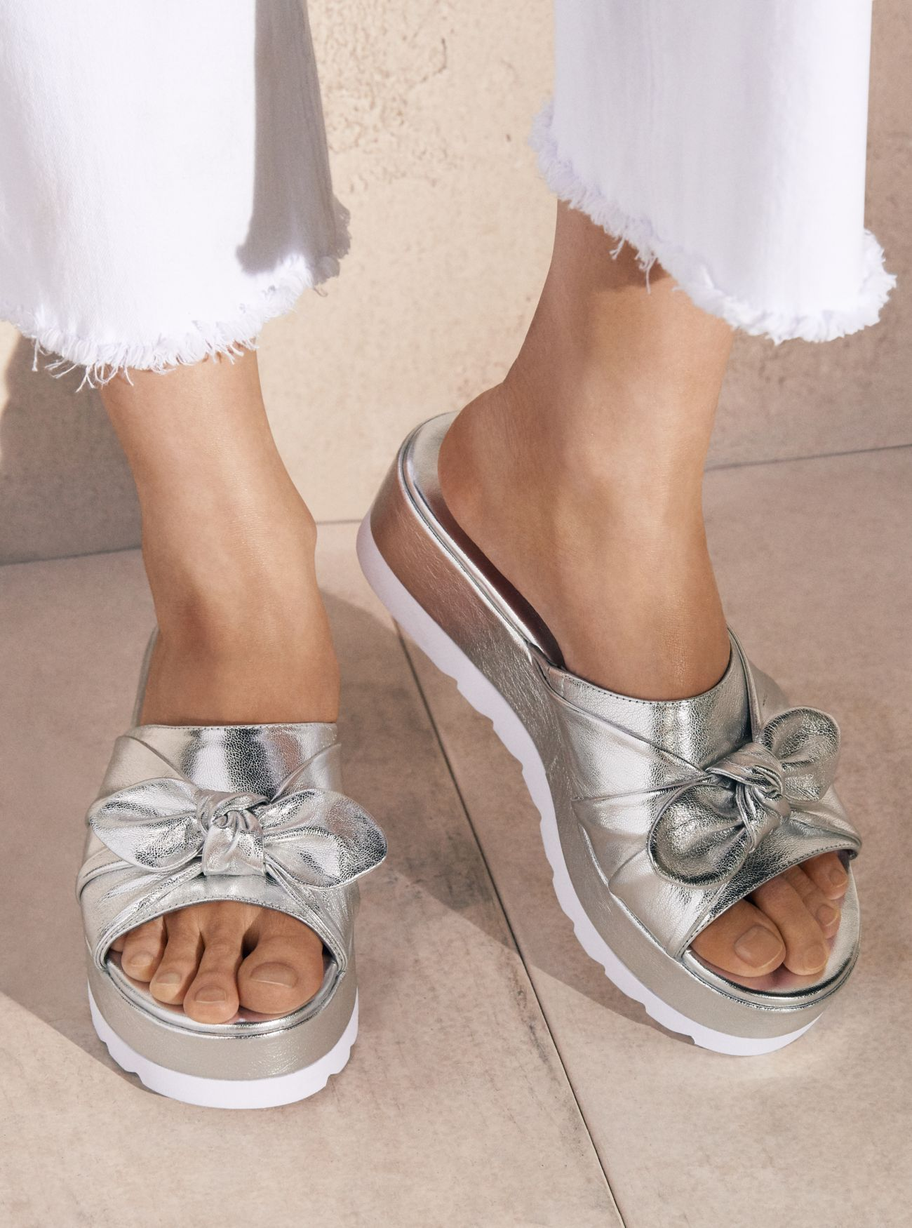 86efbb174c7 ... sandals on the official Michael Kors site. Pippa Metallic Leather  Platform Slide