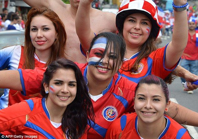 19d30ed58 Costa Rica football team fans with nation flag on color on faces ...