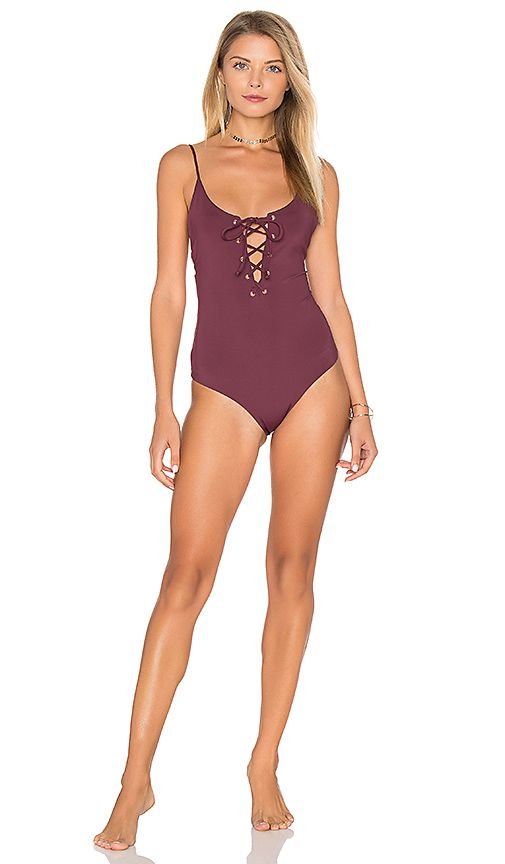 3f80b640bf Shop for TAVIK Swimwear Monahan One Piece Swimsuit in Merlot at REVOLVE. Free  2-3 day shipping and returns, 30 day price match guarantee.