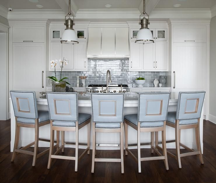 Blue Leather Counter Stools Sit At A White Curved Kitchen Island