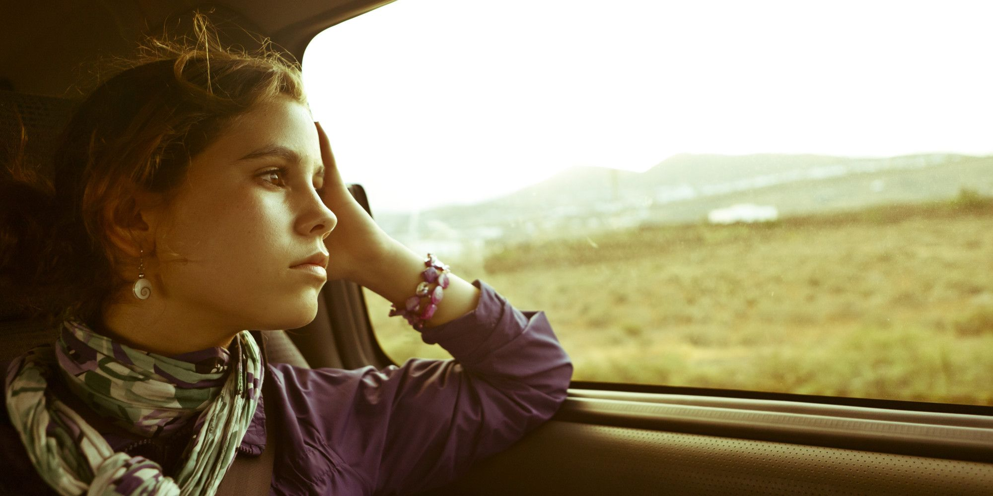 Image result for sad girl looking out car window