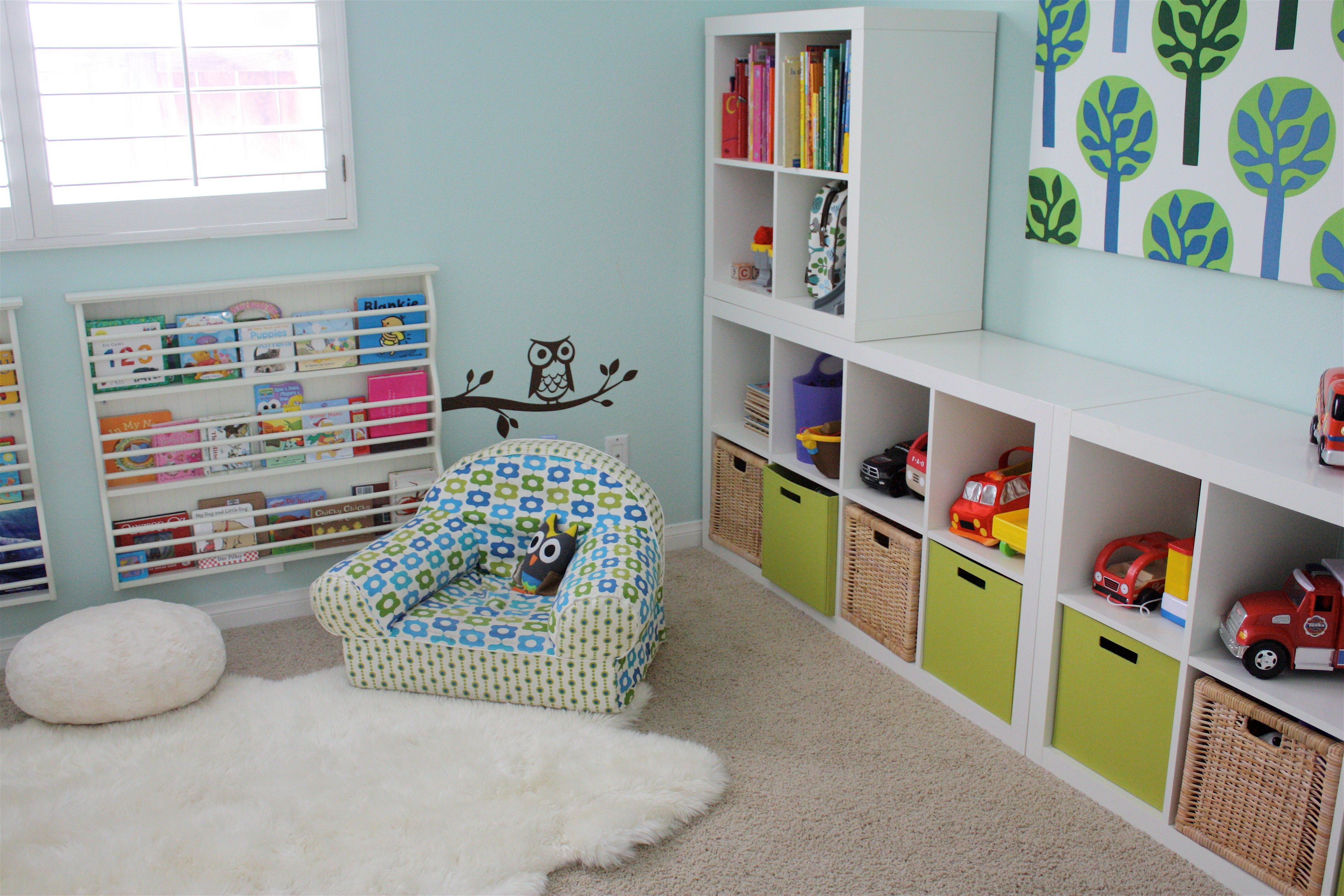 astounding picture kids playroom furniture. Mesmerizing Kids Playroom Design Ideas By White Wooden Shelves For Boxes And Toys Placed On The Brown Floor Added With Blue Sofa Chair Near Fur Rug, Astounding Picture Furniture N