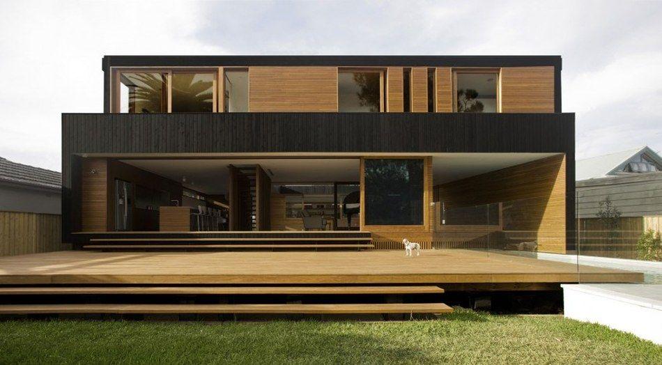 Maison contemporaine à double face au contraste improbable en - facade de maison contemporaine