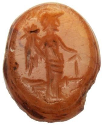 Tyche-Fortuna II-IIIsecolod.C., Intaglio su agata cornali- na gialla ,10x8x4 mm , Forma8. Figura in trono volta a destra;tiene nella mano destra cornucopia, - ACR Auctions