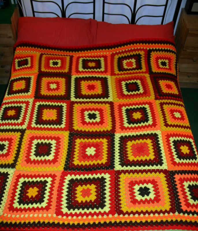 Handcrafted big granny squares crochet blanket for double bed in red, orange, yellow, brown and beige. $185.00, via Etsy.