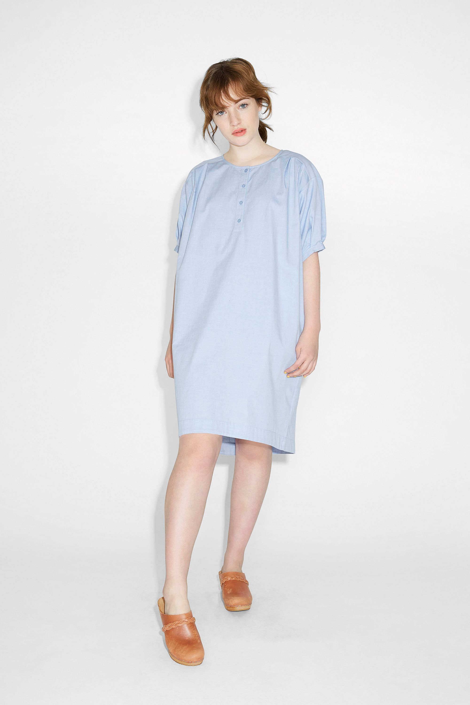 The splendid lounging, après beach, wear-for-fun-times dress. Oversized and billowy in all cotton comfort with pinched tee arms, a buttoned scoop neckline and handy side pockets.