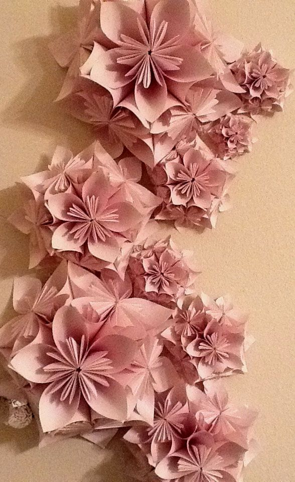 I love he delicate paper flowers of this piece and the organic shape they form.