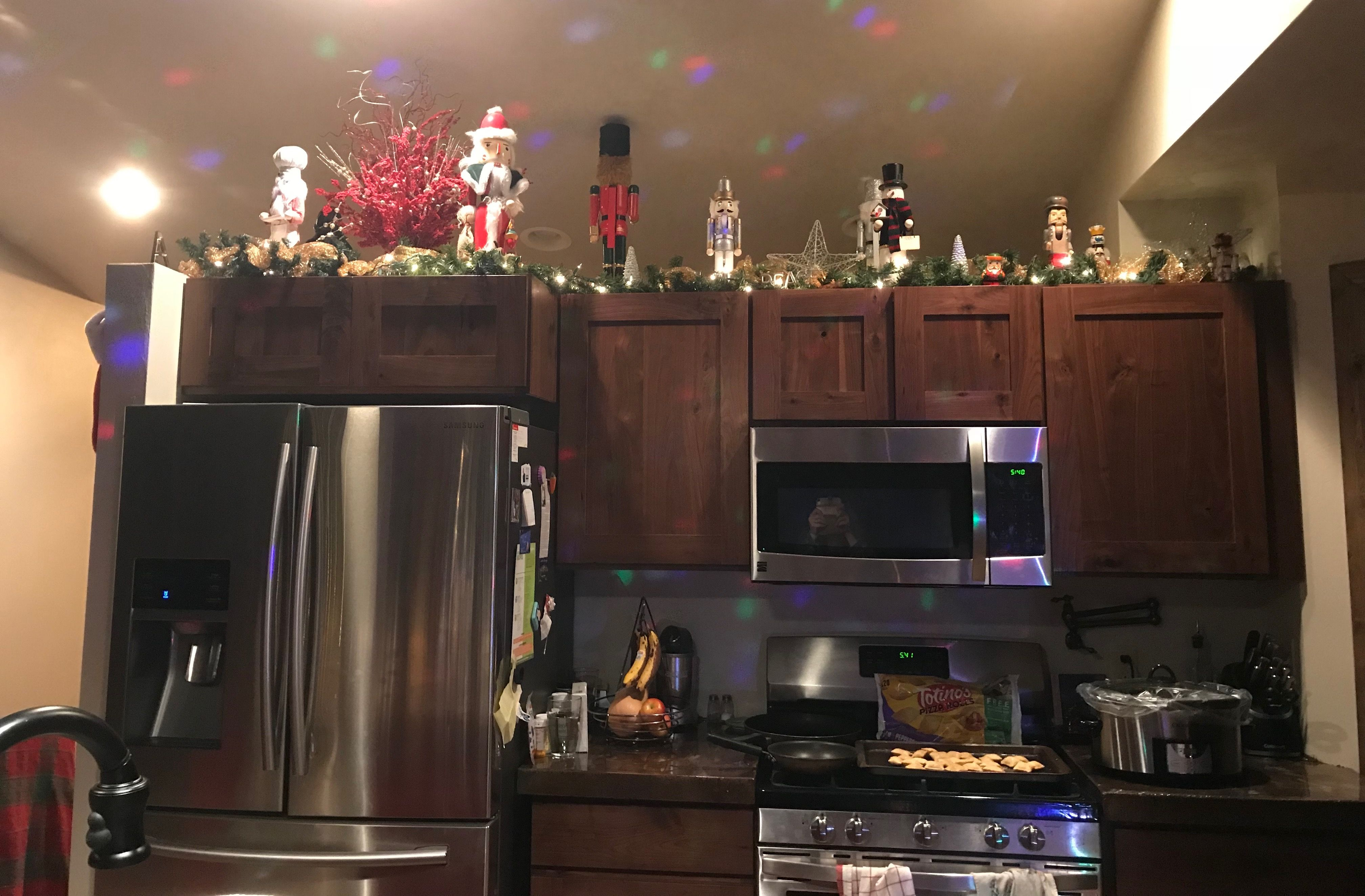 Christmas decorations above the kitchen cabinets. Lights ...