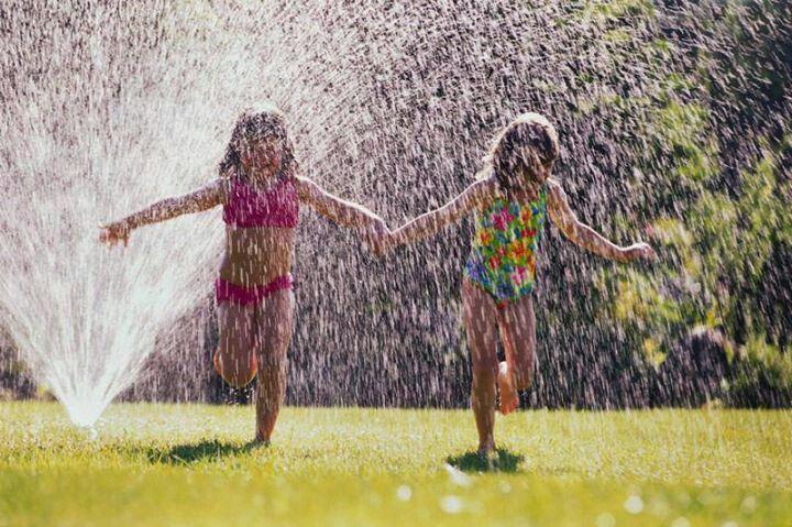 Getting wet in the sprinklers.