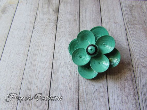 Check out this gorgeous flower brooch. It's a must have in your collection https://www.etsy.com/listing/242101454/quilled-paper-brooch-handmade-mint-green