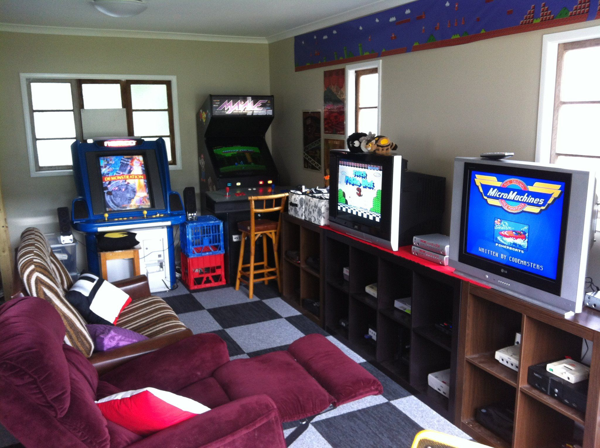Small video game and arcade gaming room in the garage by for Room decor reddit