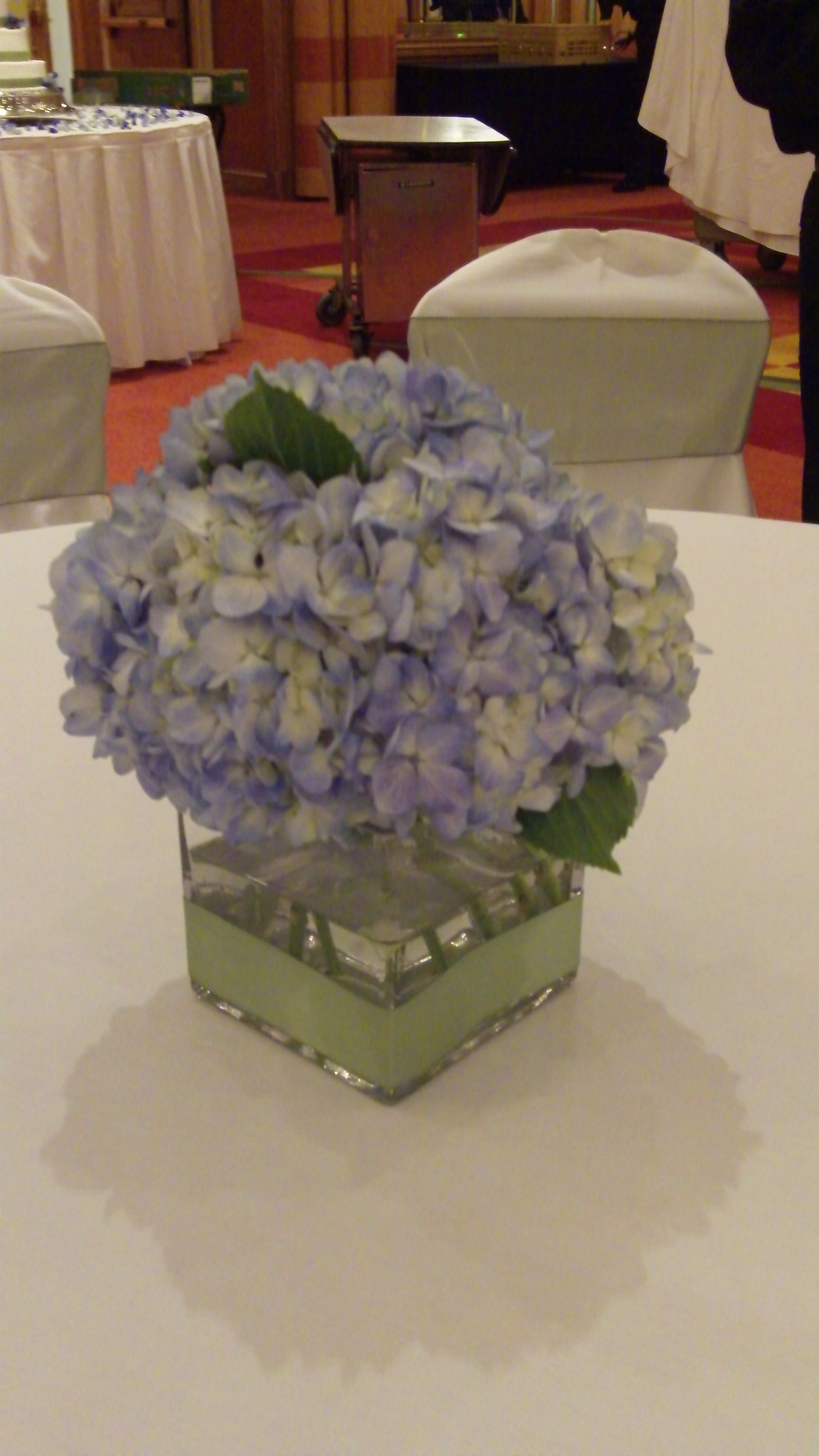 Simple and lush low centerpiece with light blue hydrangea