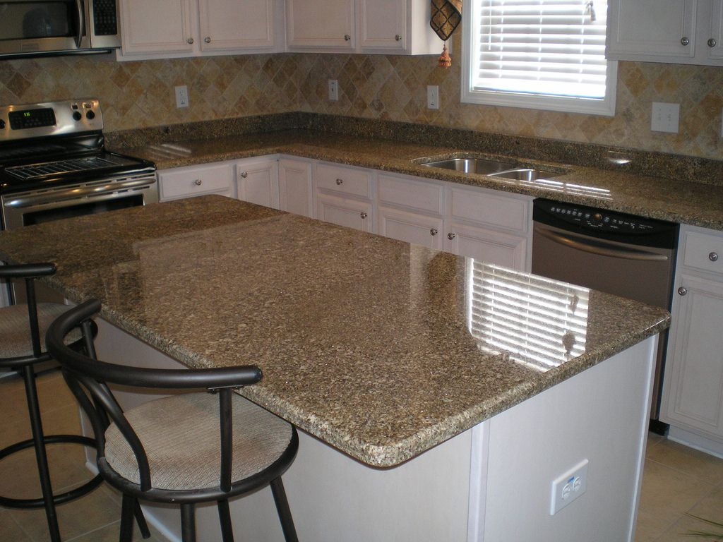 Kitchen remodel... Natural stone color with stainless and white!